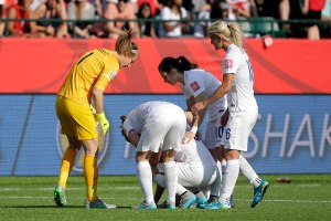 Jul 1, 2015; Edmonton, Alberta, CAN; England reacts with England defender Laura Bassett (6) after she scored an own goal during the second half against Japan in the semifinals of the FIFA 2015 Women's World Cup at Commonwealth Stadium. Mandatory Credit: Erich Schlegel-USA TODAY Sports - RTX1IOGN