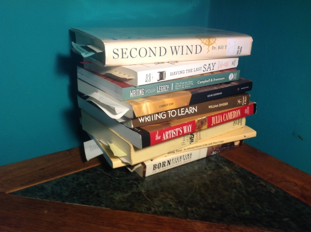 Nine books on my nightstand--and you'd see an iPad too, if I weren't using it to take the photo.