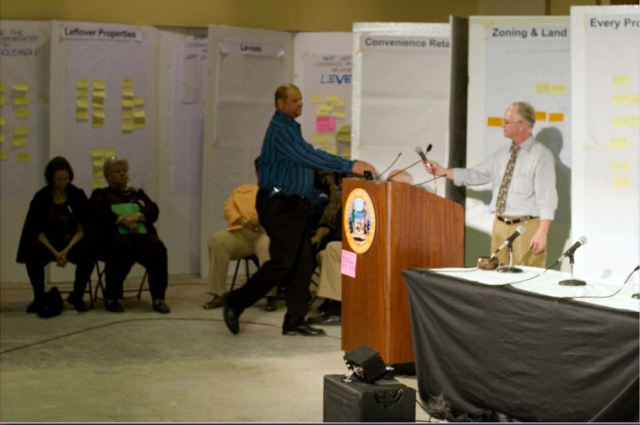 Bert Stitt calls a local official to the podium. (c) George Lottermoser, imagist.com